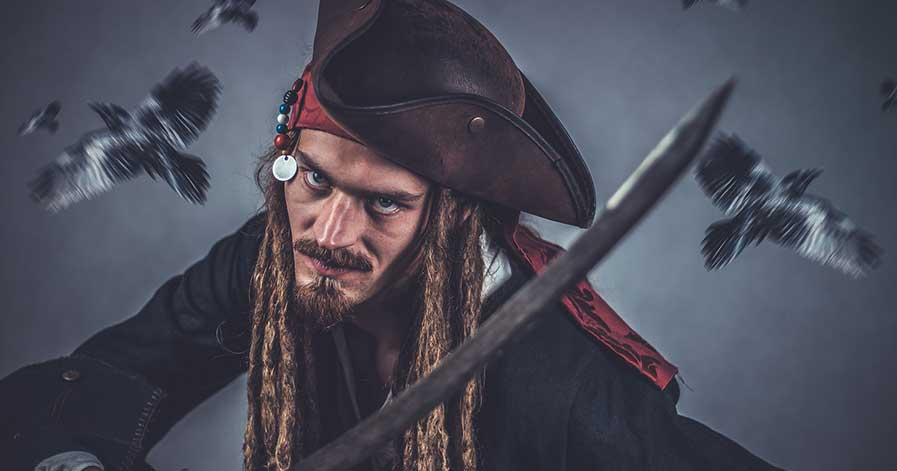 A man dressed up as a pirate.