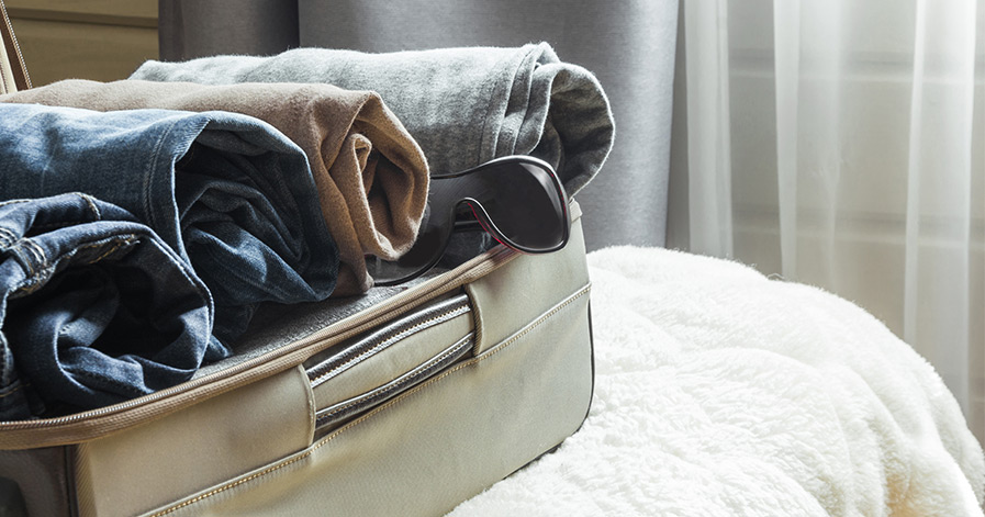Suitcase with rolled clothes