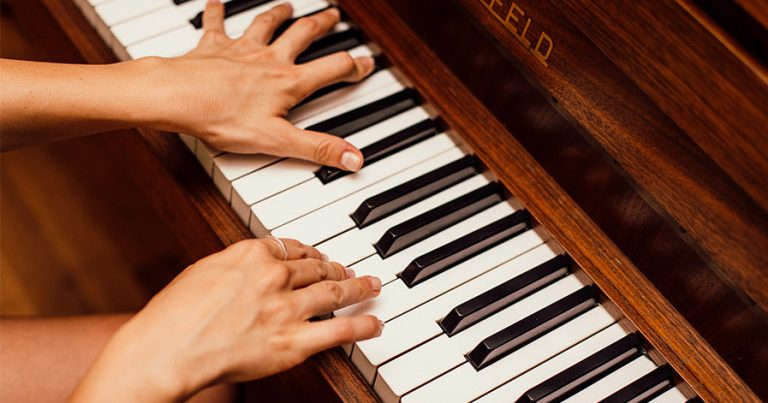 Two hands on a piano