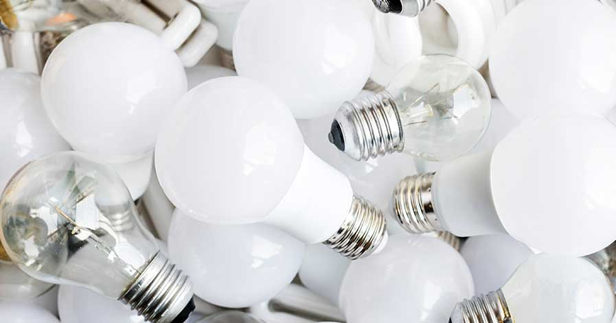 A pile of clear and white light bulbs.