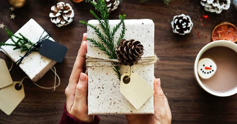 Someone holding a wrapped gift