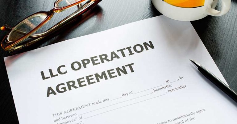 LLC agreement forms on a desk