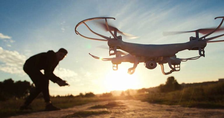 A person flying a drone outside