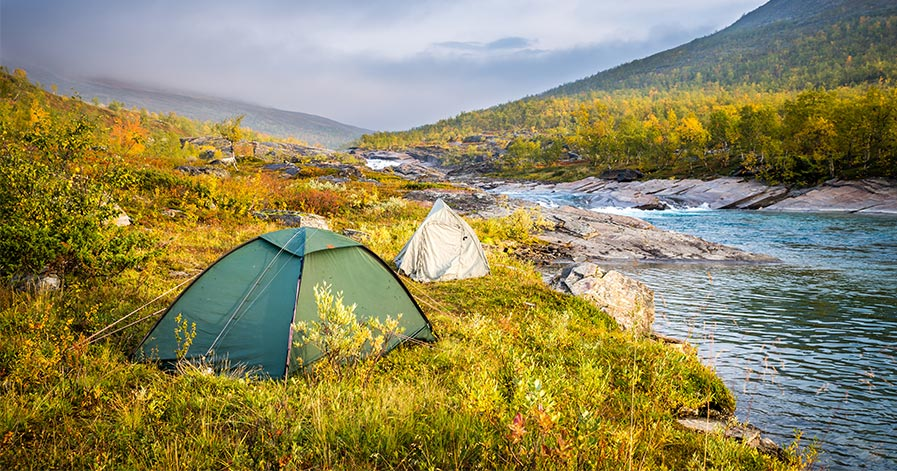 Tents on riverbank