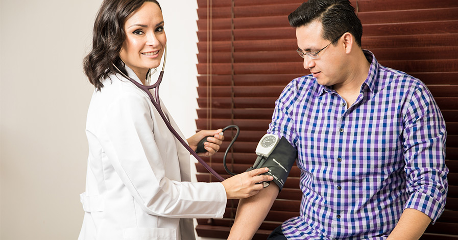 Doctor taking a man's blood pressure