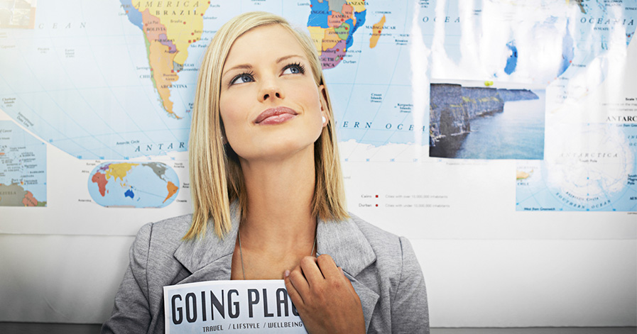 Woman sitting in front of map