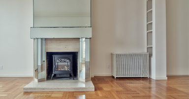 Empty room in a house with fireplace