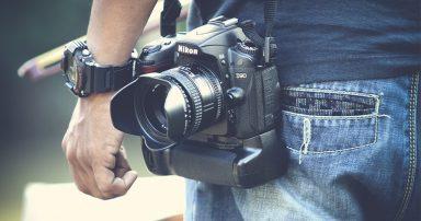 Nikon camera hanging at someone's waist