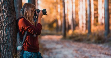 Woman taking photos outside