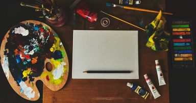 Various art supplies laid out on a table, ready for use