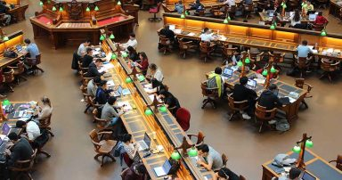 Students studying in a college library