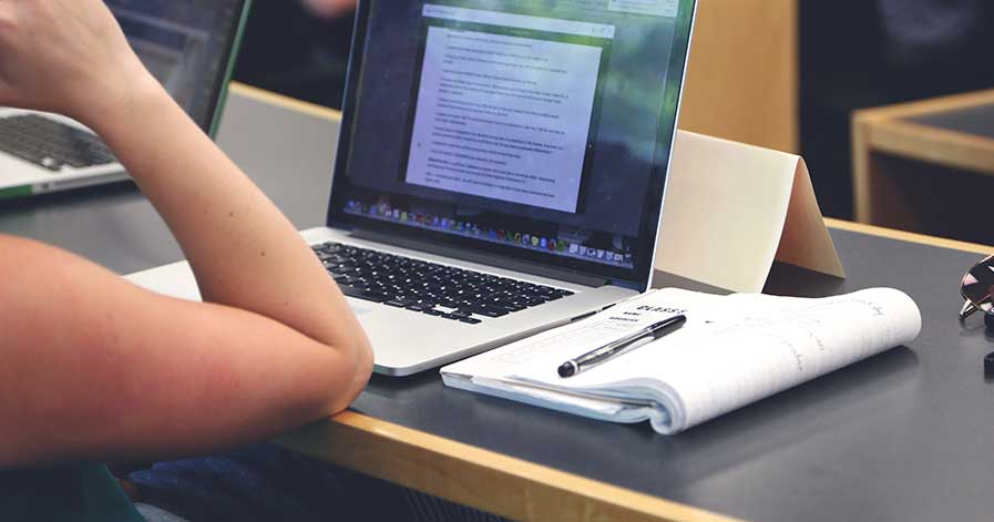 A person studying on their laptop