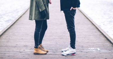 A couple standing on a dock, across from each other