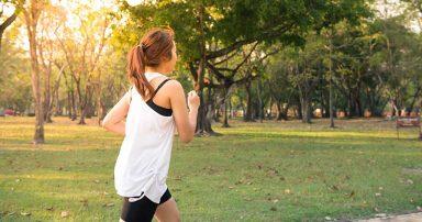 A woman running through a park