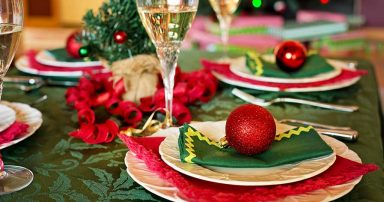 A table set for Christmas dinner, with decorations