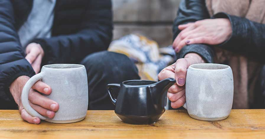 A couple are out for coffee on a blind date