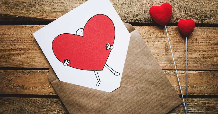 A Valentine's Day card laying on a table.