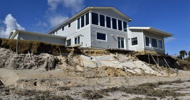 Beach erosion in front of home after hurricane