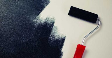 A white wall being painted black
