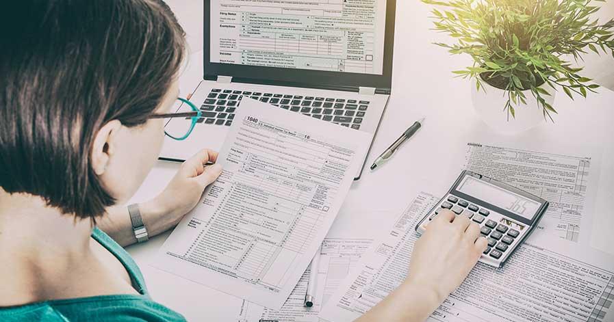 A woman preparing her taxes