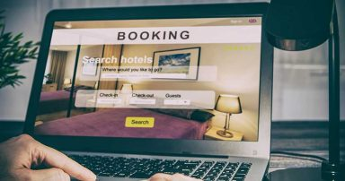A laptop screen showing a hotel booking website