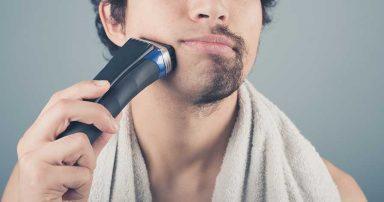 A man using an electric razor