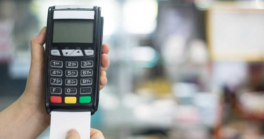 Someone inserting a credit card into a POS system