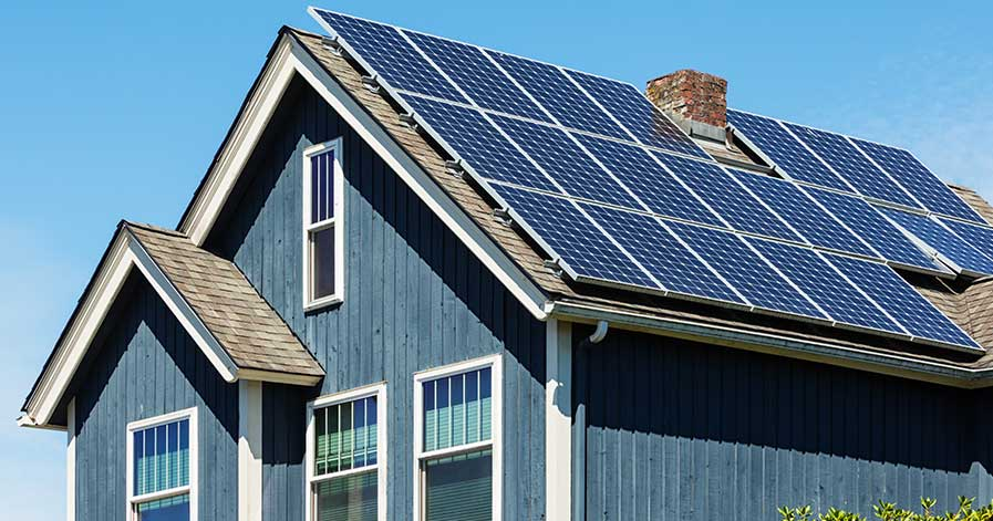A house with solar panels covering the roof