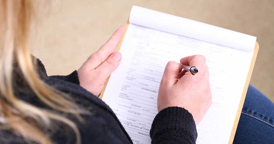 A woman filling out paper work