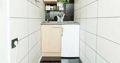 A kitchen with a mini fridge