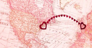 A map with hearts on it connecting New York to London, England