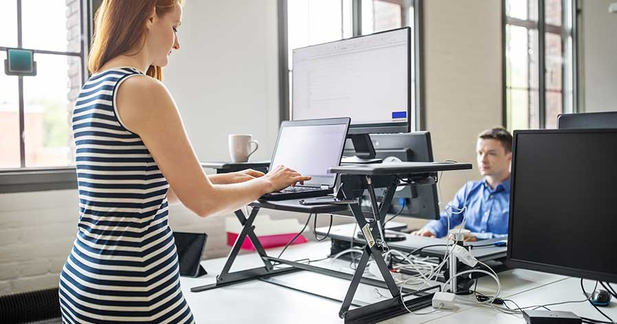 A woman using a standing desk