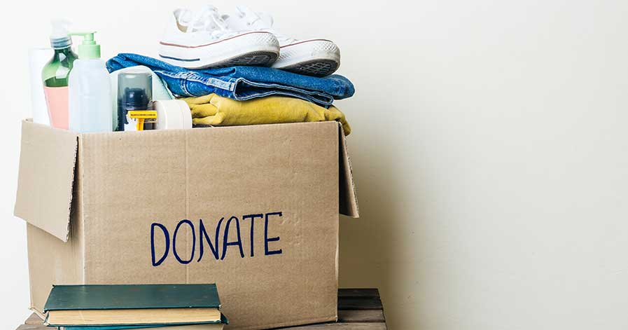 A box of clothing items marked for donation