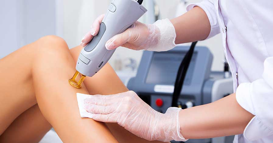 A woman having laser hair removal done on her legs