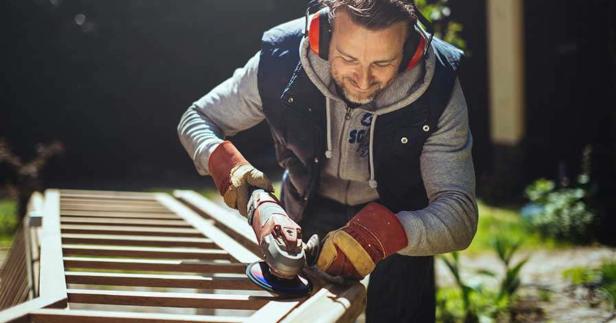 A man doing woodwork